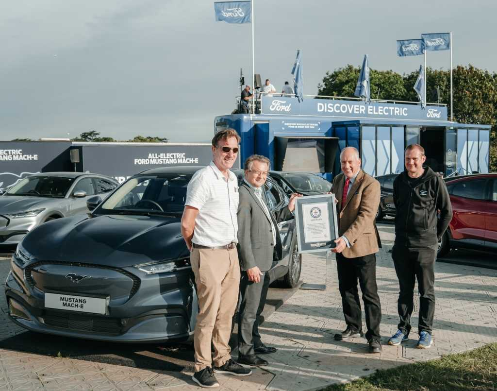 Ford's Tim Nicklin receives record certificate from left to right Mustang Mach-E drivers Fergal McGrath, Paul Clifton and Kevin Booker